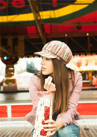 Portrait of Young Woman at Amusement Park, Mannheim, Baden-Wurttermberg, Germany Stock Photo - Premium Royalty-Free, Code: 600-07156261