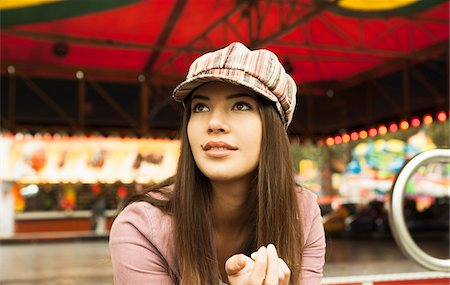 Portrait of Young Woman at Amusement Park, Mannheim, Baden-Wurttermberg, Germany Stock Photo - Premium Royalty-Free, Code: 600-07156262