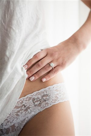 """ring hand woman - Close-up of Bride wearing """"I do"""" Underwear Stock Photo - Premium Royalty-Free, Code: 600-07199688"""