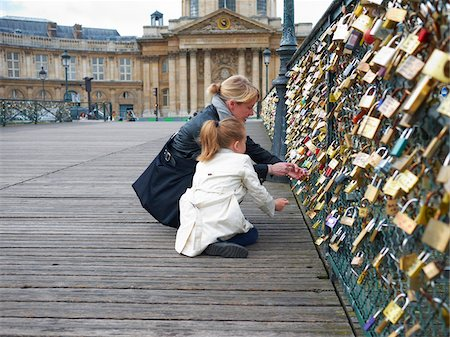 Mother and Daughter looking at Love Locks on Pont Des Arts, Paris, France Stock Photo - Premium Royalty-Free, Code: 600-07199703