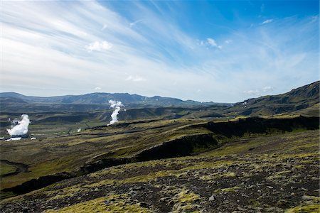 View of the Nesjavellir Geothermal Power Station with white smoke, blue sky, clouds streaked moss green and mountains, Nesjavellir, Iceland, Europe Stock Photo - Premium Royalty-Free, Code: 600-07199798