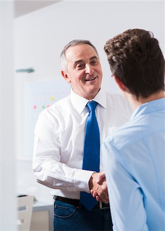 staff - Businessman shaking hands with apprentice in office, Germany Stock Photo - Premium Royalty-Free, Code: 600-07199805