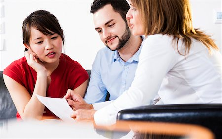 Businesswoman in discussion with young couple, Germany Stock Photo - Premium Royalty-Free, Code: 600-07199925