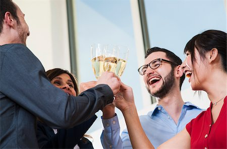 Business people holding champagne glasses and toasting each other in office, Germany Stock Photo - Premium Royalty-Free, Code: 600-07199921
