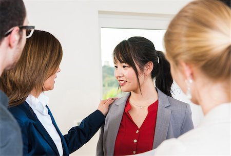 Group of young business people and businesswoman in discussion in office, young business woman being congratulated, Germany Stock Photo - Premium Royalty-Free, Code: 600-07199948