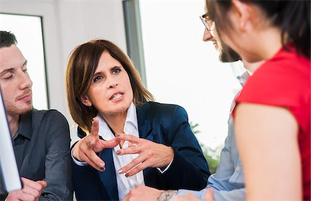 Businesswoman in discussion with group of young business people, Germany Stock Photo - Premium Royalty-Free, Code: 600-07199955