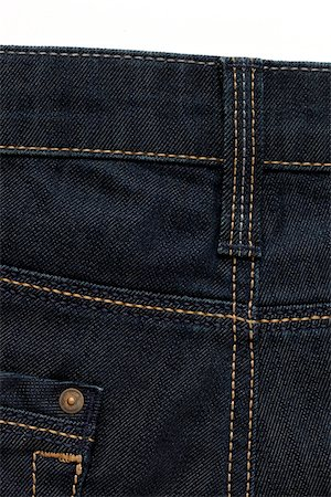 Close-up, backview of blue jeans, studio shot Stock Photo - Premium Royalty-Free, Code: 600-07192108