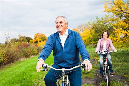 Couple Riding Bicycles in Autumn, Mannheim, Baden-Wurttemberg, Germany Stock Photo - Premium Royalty-Free, Code: 600-07192139