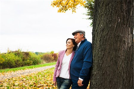 Couple leaning against Tree Trunk, Mannheim, Baden-Wurttmeberg, Germany Stock Photo - Premium Royalty-Free, Code: 600-07192148