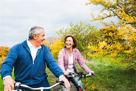 Couple Riding Bicycles in Autumn, Mannheim, Baden-Wurttemberg, Germany Stock Photo - Premium Royalty-Free, Code: 600-07192140