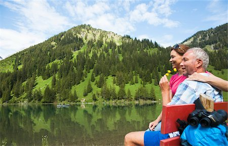 Mature Couple Relaxing at Lake, Vilsalpsee, Tannheim Valley, Tyrol, Austria Stock Photo - Premium Royalty-Free, Code: 600-07192155