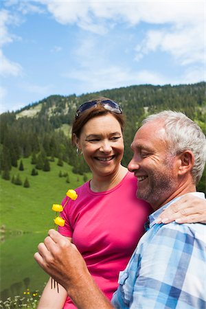 Mature Couple Relaxing at Lake, Vilsalpsee, Tannheim Valley, Tyrol, Austria Stock Photo - Premium Royalty-Free, Code: 600-07192156