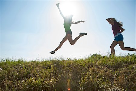 Girls Running and Jumping Outdoors, Mannheim, Baden-Wurttemberg, Germany Stock Photo - Premium Royalty-Free, Code: 600-07192159