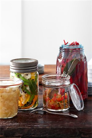 Multiple Jars of Homemade Pickled Vegetable Relish and Salsa Stock Photo - Premium Royalty-Free, Code: 600-07204037