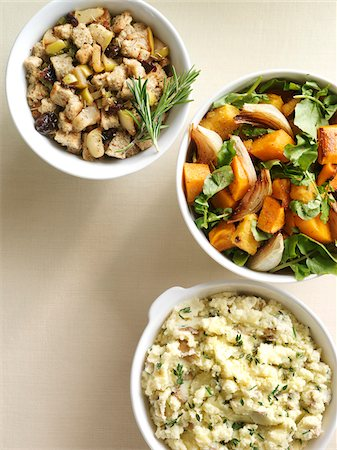 Overhead View of Side Dishes of Squash, Potatoes and Stuffing, Studio Shot Stock Photo - Premium Royalty-Free, Code: 600-07204049