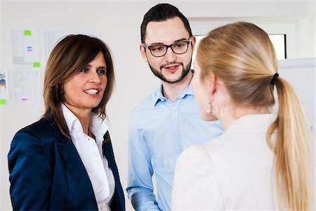 Close-up of mature business woman meeting with two young business people, in discussion, Germany Stock Photo - Premium Royalty-Free, Code: 600-07200044