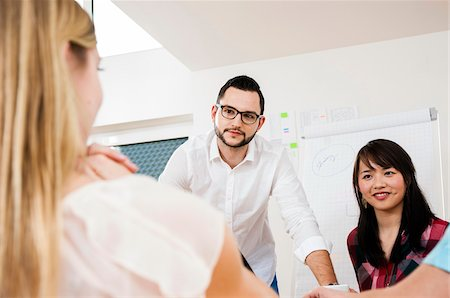 staff - Group of young business people meeting and in discussion in office, Germany Stock Photo - Premium Royalty-Free, Code: 600-07202775