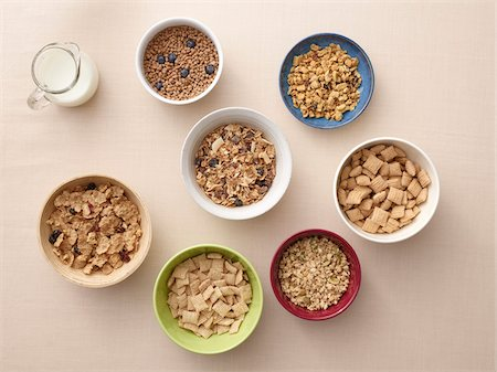 Overhead view of bowls of a variety of healthy cereals and jug of milk, studio shot Stock Photo - Premium Royalty-Free, Code: 600-07203967