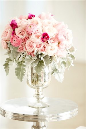 Bouquet of pink roses in silver vase on silver table, studio shot Stock Photo - Premium Royalty-Free, Code: 600-07203963