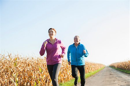 Couple Jogging Outdoors, Baden-Wurttemberg, Germany Stock Photo - Premium Royalty-Free, Code: 600-07236609