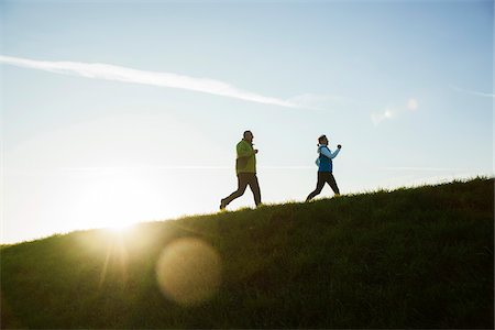 sun - Man and Woman Jogging Outdoors, Baden-Wurttemberg, Germany Stock Photo - Premium Royalty-Free, Code: 600-07236621