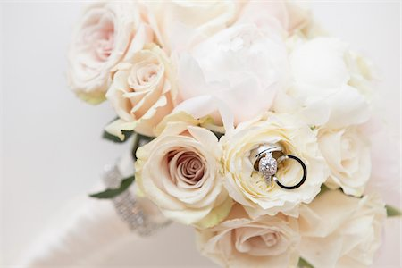 Close-up of Rings in Bouquet of Roses, Studio Shot Stock Photo - Premium Royalty-Free, Code: 600-07237575