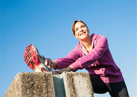 Mature Woman Stretching Outdoors, Mannheim, Baden-Wurttemberg, Germany Stock Photo - Premium Royalty-Free, Code: 600-07237888