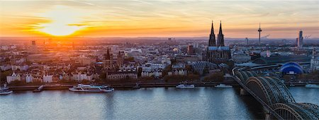 fall - Elevated View of Hohenzollern Railroad Bridge over River Rhine by Cologne Cathedral at Sunset, North Rhine-Westphalia, Germany Stock Photo - Premium Royalty-Free, Code: 600-07238076