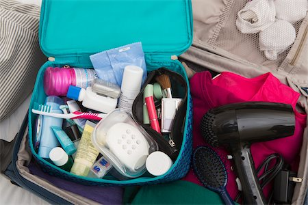 Women's Toiletry Travel Bag in Packed Suitcase Stock Photo - Premium Royalty-Free, Code: 600-07232295