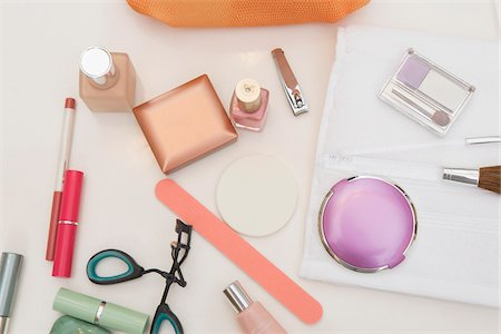 Overhead View of Bathroom Countertop with Women's Cosmetics and Beauty Products Stock Photo - Premium Royalty-Free, Code: 600-07232291