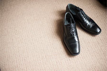 pair - Black Dress Shoes on Carpet Stock Photo - Premium Royalty-Free, Code: 600-07232321