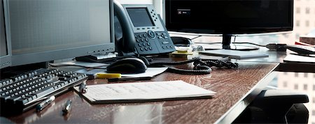 phone cord - Desk in office with computer monitors, phone and paperwork, Canada Stock Photo - Premium Royalty-Free, Code: 600-07240805