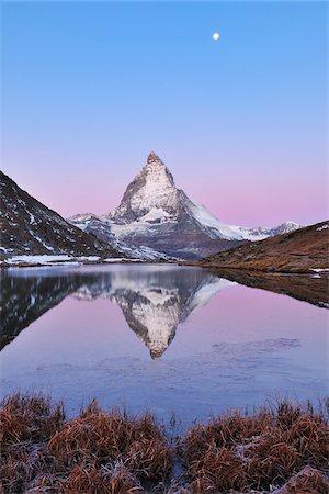 Matterhorn reflected in Lake Riffelsee at Dawn with Moon, Zermatt, Alps, Valais, Switzerland Stock Photo - Premium Royalty-Free, Code: 600-07278757