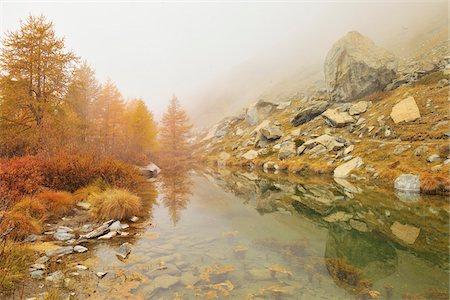 Mountain Lake with Fog in Autumn, Grindjesee, Findeln, Zermatt, Alps, Valais, Switzerland Stock Photo - Premium Royalty-Free, Code: 600-07278752