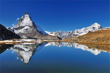 scenic - Matterhorn reflected in Lake Riffelsee, Zermatt, Alps, Valais, Switzerland Stock Photo - Premium Royalty-Free, Code: 600-07278762