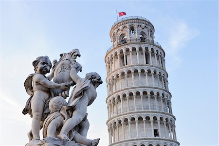 Cherub Statue of Fontana Dei Putti with Leaning Tower of Pisa, Piazza dei Miracoli, Pisa, Tuscany, Italy Stock Photo - Premium Royalty-Free, Code: 600-07288054