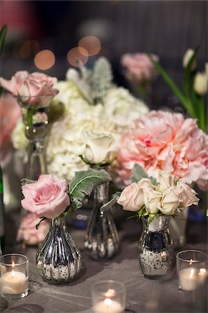 peony - Close-up of vases with roses and peonies on table with candlelit votive holders at reception, Canada Stock Photo - Premium Royalty-Free, Code: 600-07311009