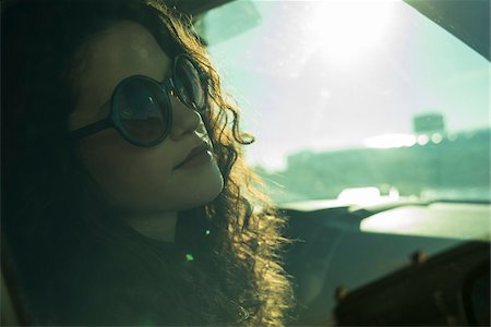 dark glasses - Close-up portrait of teenage girl sitting in car, wearing sunglasses, Germany Stock Photo - Premium Royalty-Free, Code: 600-07311089