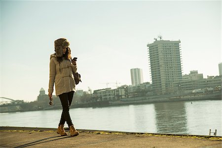 Teenage girl outdoors, walking along waterfront at loading dock, Mannheim, Germany Stock Photo - Premium Royalty-Free, Code: 600-07311102