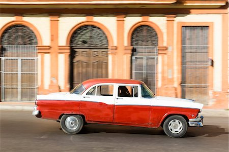 Vintage car in front of historic architecture, Havana, Cuba Stock Photo - Premium Royalty-Free, Code: 600-07311168