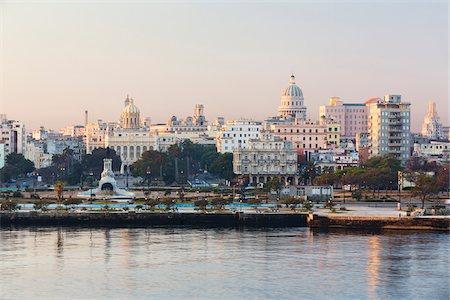 Skyline of Havana with El Capitolio at sunrise, Havana, Cuba Stock Photo - Premium Royalty-Free, Code: 600-07311171