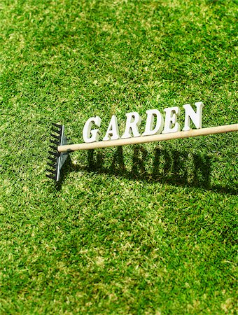 Garden Rake with the Text Garden on Grass Stock Photo - Premium Royalty-Free, Code: 600-07311266