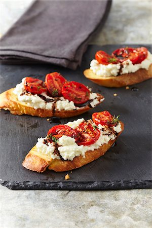 Appetizer of Ricotta and Tomatoes on Bread, Studio Shot Stock Photo - Premium Royalty-Free, Code: 600-07311279