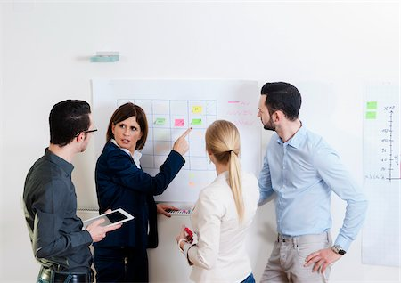 Group of young business people and mature businesswoman in discussion in office, Germany Stock Photo - Premium Royalty-Free, Code: 600-07311404