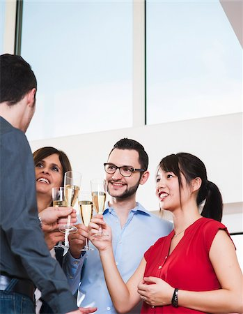 Mature businesswoman toasting group of young business people with glasses of champagne, Germany Stock Photo - Premium Royalty-Free, Code: 600-07311406
