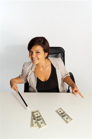 short hair - Mid-Adult Woman doing Magic with Magic Wand and $100 Bills Stock Photo - Premium Royalty-Free, Code: 600-07355322