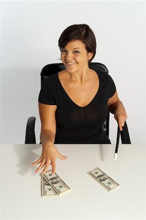 short hair - Mid-Adult Woman doing Magic with Magic Wand and $100 Bills Stock Photo - Premium Royalty-Free, Code: 600-07355323