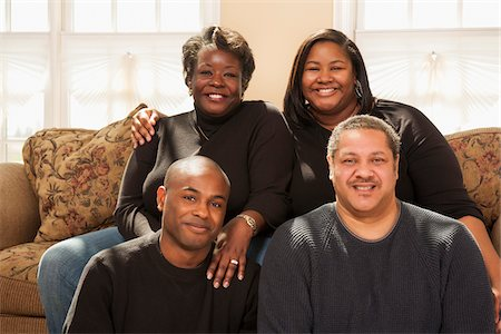 fat black woman - Portrait of Adult Family on Sofa Stock Photo - Premium Royalty-Free, Code: 600-07368546
