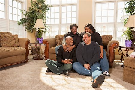 fat lady sitting - Portrait of Adult Family in Living Room Stock Photo - Premium Royalty-Free, Code: 600-07368547