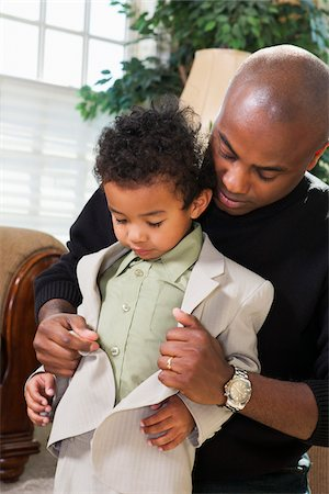 Father Helping Son Button Suit Jacket, Getting Ready for Church Stock Photo - Premium Royalty-Free, Code: 600-07368542